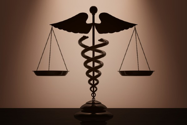 Medical caduceus symbol and the scales of justice